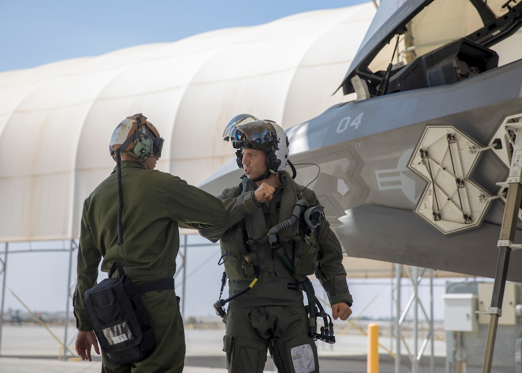 U.S. Marine Corps Lt. Col. Alexander Goodno, commanding officer of Marine Fighter Attack Squadron (VMFA) 225, greets another Marine during his final checks, before boarding his jet at Marine Corps Air Station Yuma, Ariz., September 25, 2021. VMFA-225 participated in their first flight as an F-35B squadron. This marked the end of the first phase in the transition from a legacy F/A-18D Hornet squadron to an F-35B squadron. (U.S. Marine Corps Photo by Lance Cpl. Matthew Romonoyske-Bean)