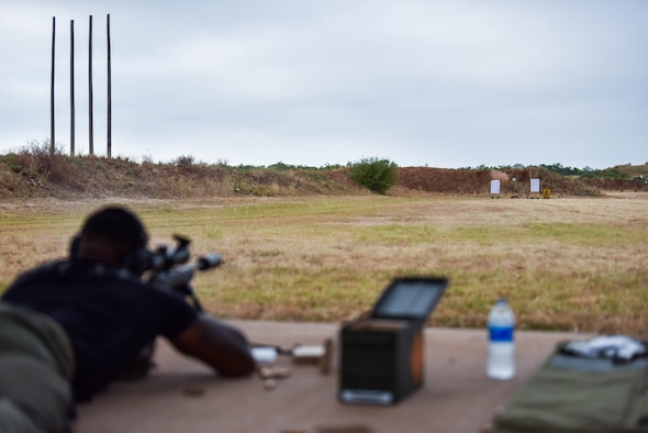 U.S. Air Force Staff Sgt. Christopher Little, 17th Security Forces Squadron flight chief, fires at a target during the joint marksmanship training course at the San Angelo Police Department firing range in San Angelo, Texas, Sept. 29, 2021. Members shot at targets from various distances while performing corrections on first-round impacts to help them improve their accuracy. (U.S. Air Force photo by Senior Airman Jermaine Ayers)