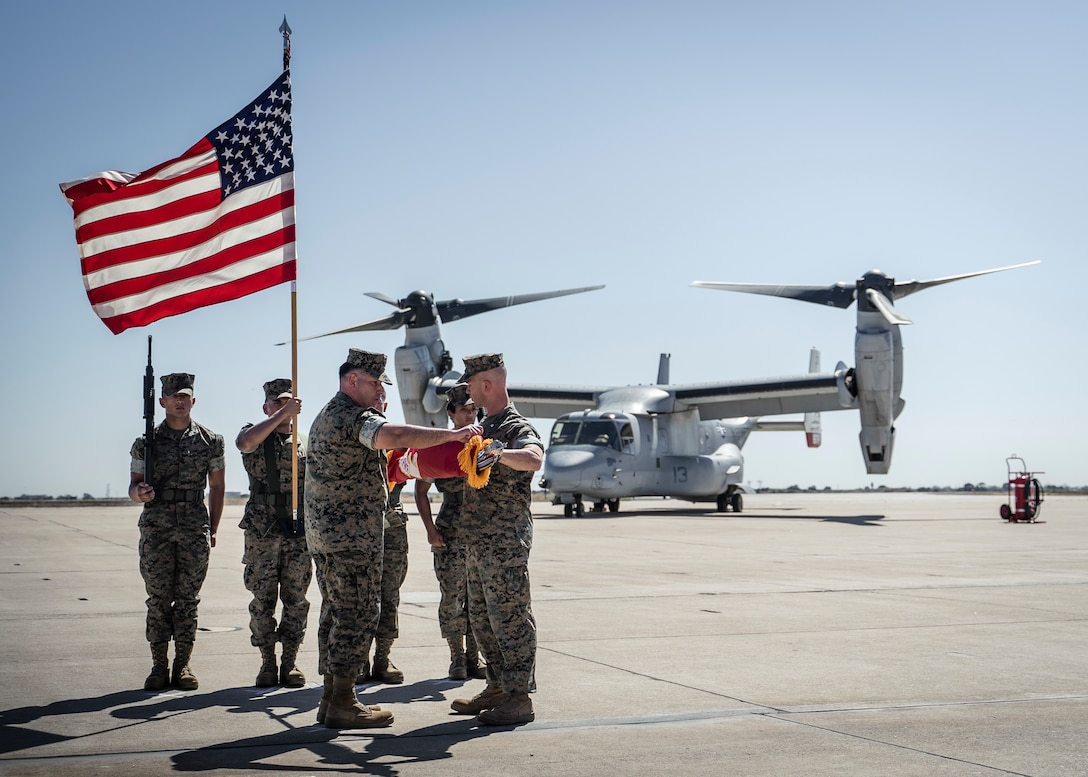 U.S. Marine Corps Lt. Col. James Clifford Ford III, commanding officer, Marine Medium Tilt Rotor Squadron (VMM) 166, Marine Aircraft Group (MAG) 16, 3rd Marine Aircraft Wing (MAW), and Sgt. Maj. Mohammad A. Arzola, sergeant major, VMM-166, MAG-16, 3rd MAW, case the colors for VMM-166 at a deactivation ceremony on Marine Corps Air Station Miramar, Oct. 1, 2021. VMM-166 was deactivated in accordance with Force Design 2030, as the latest effort to continue to have an advantage over adversaries. (U.S. Marine Corps photo by Cpl. Carlos Kealy)