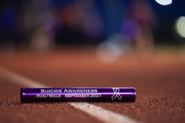 A baton is displayed on the Mathis Field track during the Suicide Awareness 24-Hour Run/Walk on Goodfellow Air Force Base.