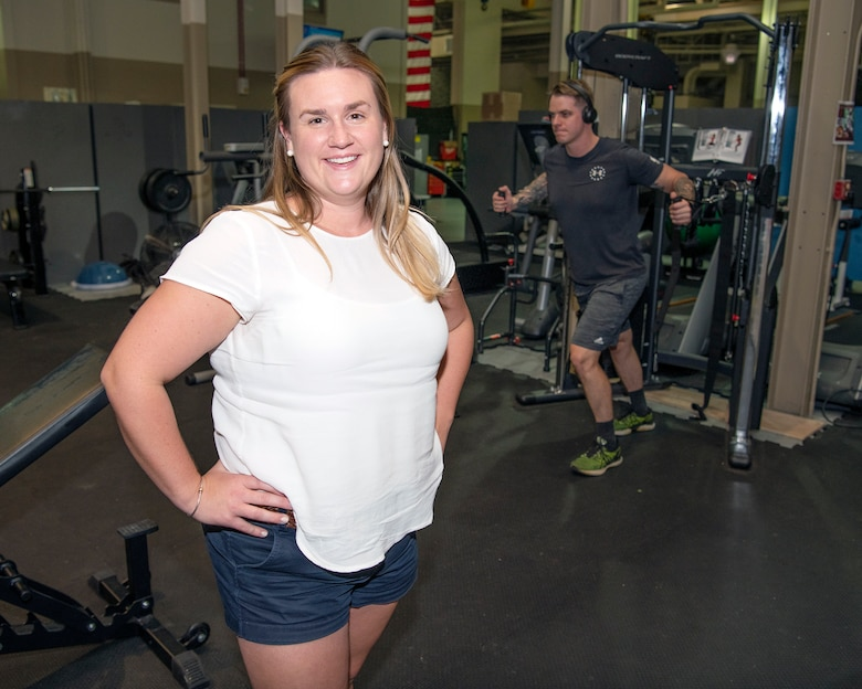 Ellie Goldense, an athletic trainer with the Preservation of the Force and Family takes the time for a photo in her work area at Hurlburt Field, Florida, Sept. 23, 2021. Goldense is the only athletic trainer embedded into the 2nd Special Operations Squadron and supports the whole second shift team for the flying units within the 2nd SOS, 65th Special Operations Squadron, and the 311th Special Operations Intelligence Squadron. (U.S. Air Force photo by Michelle Gigante)