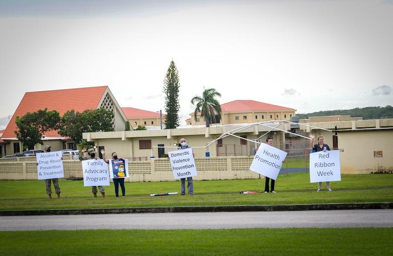 Members of Team Andersen participate in an awareness wave on Andersen Air Force Base, Guam, Oct. 4, 2021.