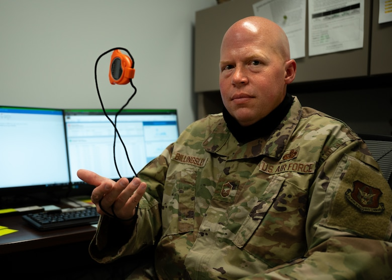 U.S. Air Force Senior Master Sgt. Jason Billingsley, the superintendent for the 442d Sustainment Services Flight, is photographed with a stopwatch