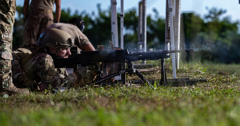 Airman 1st Class Malaka Bewar, 18th Security Forces Squadron armorer, fires an M240B machine gun at Camp Hansen, Japan, on Sept. 30, 2021. Heavy machine gun teams fire in two-man teams with the assistant gunner providing assisted stabilization, reloading and barrel changes for the primary gunner. (U.S. Air Force photo by Airman 1st Class Stephen Pulter)