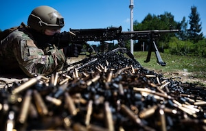 Senior Airman Gabriel Micks, 18th Security Forces Squadron member, fires an M240B at Camp Hansen, Japan, Sept. 30, 2021. The 18th SFS provides aircraft security and maintains the largest security force mobility commitment in the Pacific Air Forces. (U.S. Air Force photo by Airman 1st Class Stephen Pulter)