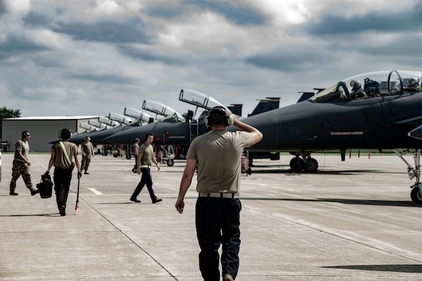 U.S. Air Force pilots and maintainers assigned to the 336th Fighter Squadron prepare F-15E Strike Eagle aircraft on the flightline at Terre Haute Regional Airport in preparation for exercise Jaded Thunder at Hulman Field Air National Guard Base, Ind., Aug. 15, 2021. Hulman Field, which is a dual-purpose, military and civilian airfield, is home to the Indiana National Guard's 181st Intelligence Wing. (U.S. Air National Guard photo by Tech. Sgt. L. Roland Sturm)