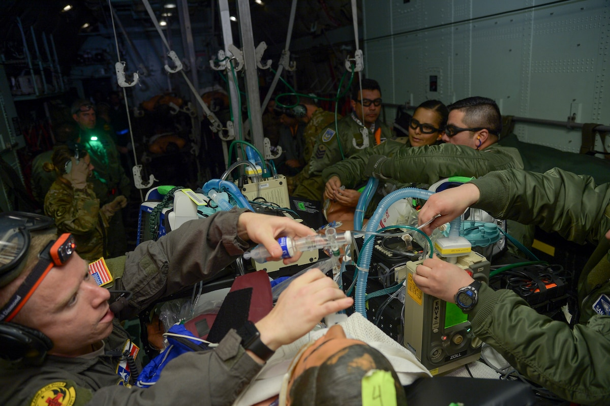 U.S. Air Force and Chilean Air Force medical professionals treat simulated patients aboard a Chilean Air Force KC-130R aircraft during aeromedical evacuation training mission during Exercise Mobility Guardian at Moses Lake, located west of Fairchild Air Force Base, Wash., Sept. 23, 2019. The Chilean medical Airmen integrated with U.S. critical care air transport teams and aeromedical evacuation Airmen to treat, stabilize and transport 37 simulated patents on a Chilean Air Force KC-130R. (U.S. Air Force photo by Tech. Sgt. Angela Ruiz)