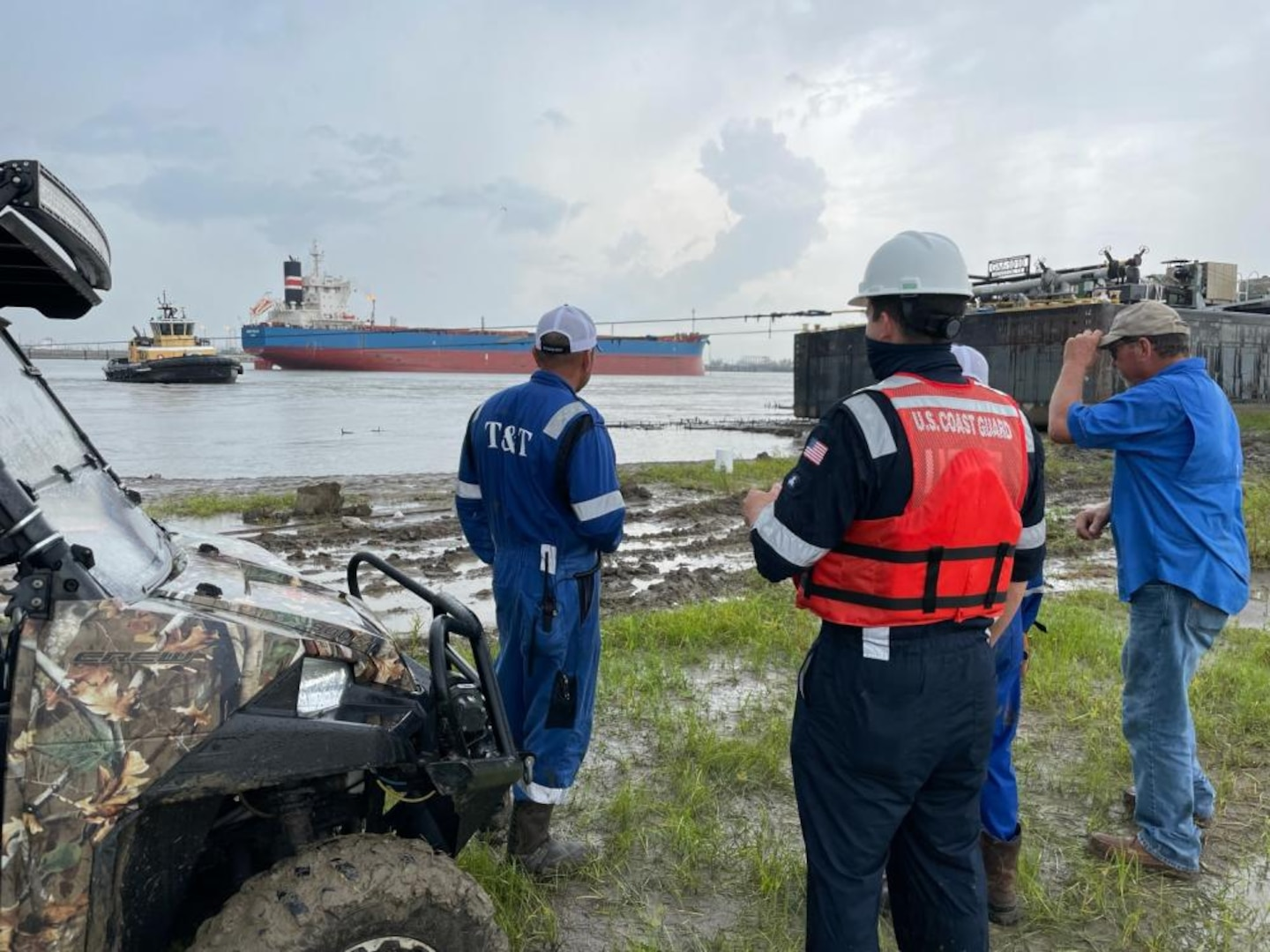 Coast Guard Salvage Engineering Response Team (SERT) provides technical analysis and assistance to salvors attempting to free grounded Genesis Marine barges on the Bonnet Carre Spillway Sept. 6, 2021. The SERT worked alongside the salvage master and representatives from T&T Salvage and Genesis Marine to free the barges. (U.S. Coast Guard photo)