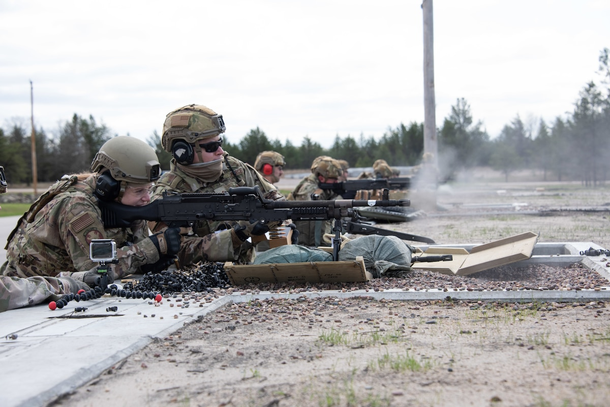 Members of the 114th Security Forces Squadron with South Dakota Air National Guard conduct  Weapons Qualification firing the M240 machine gun, M249 machine gun and M203 grenade launcher at Fort McCoy, Wis (U.S. Air Force photo)