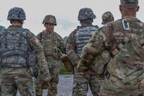 Sgt. Maj. of the Army Michael A. Grinston provides feedback to Soldiers