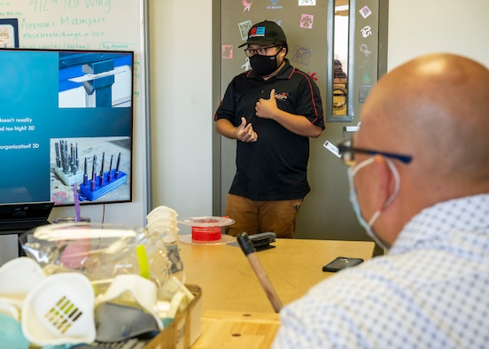 Jeremy Germita, 412th Communications Squadron, presents a 3-D Printing Basic Workshop at Edwards Air Force Base, Sept. 22. The workshop was hosted by the 412th Test Wing Innovation Team, SparkED. (Air Force photo by Katherine Franco)