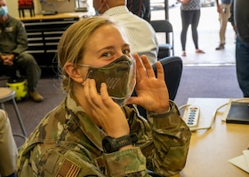 1st Lt. Arielle Miller, 412th Medical Group, showcases a prototype facemask shield during a 3-D Printing Basic Workshop at Edwards Air Force Base, Sept. 22. The workshop was hosted by the 412th Test Wing Innovation Team, SparkED. (Air Force photo by Katherine Franco)