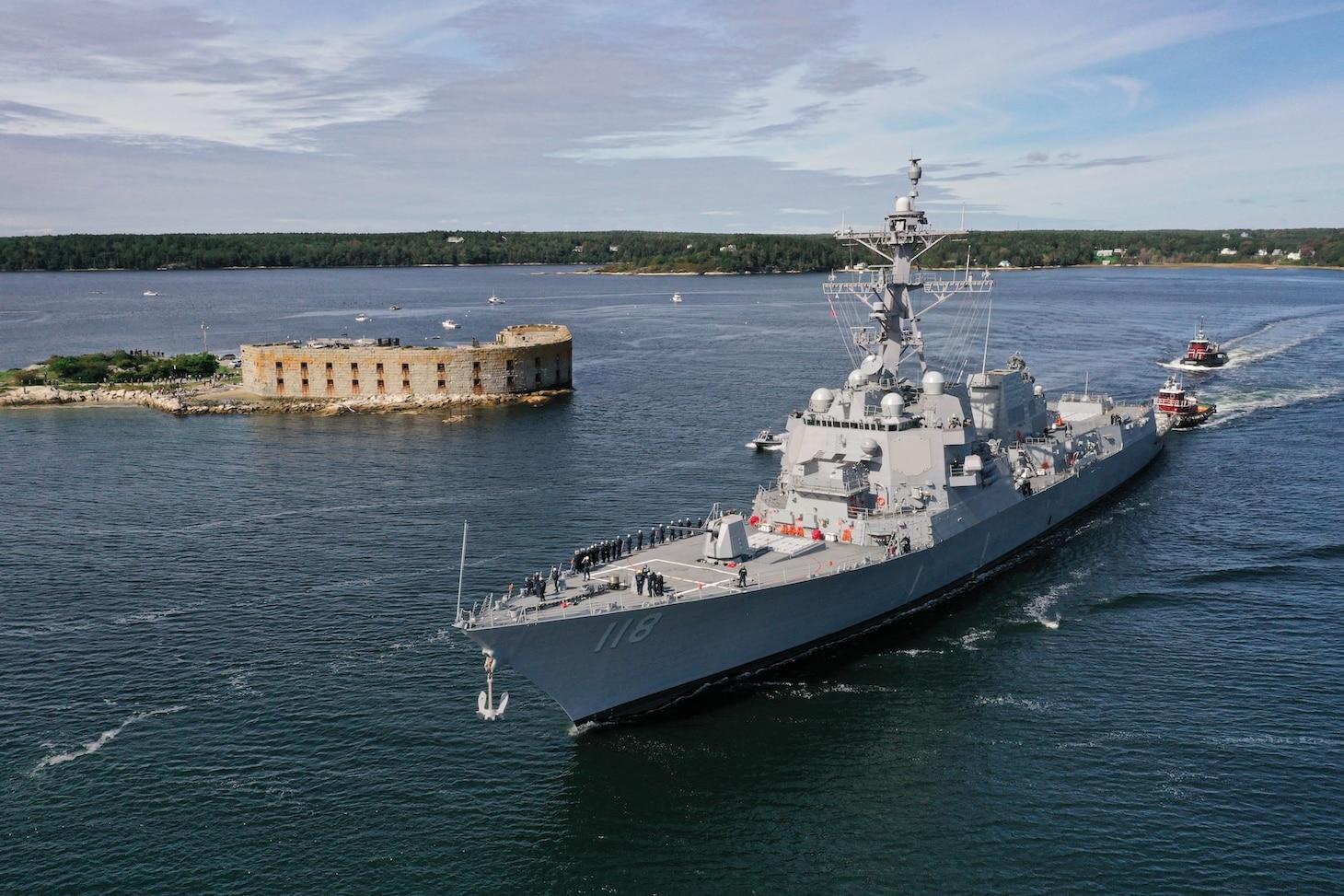 The future USS Daniel Inouye (DDG 118) departs General Dynamics Bath Iron Works shipyard.