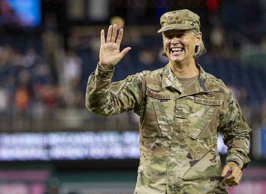 Air Force Maj. Gen. Sherrie McCandless, commanding general of the District of Columbia National Guard, waves to the crowd after throwing the ceremonial first pitch during National Guard Day at Nationals Park in Washington, Aug. 13, 2021. The Washington Nationals dedicate a special game each season to honor and celebrate each branch of the military.