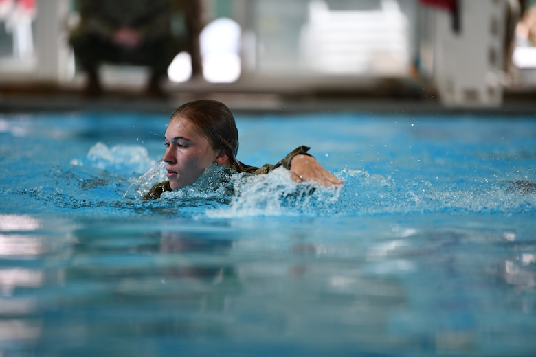 Staff Sgt. Sara Kolinski, 104th Fighter Wing public affairs specialist, swims during the German Armed Forces Proficiency Badge event Sept. 9, 2021, at Hanscom Air Force Base, Massachusetts. Participants were tested over a three-day period on swimming, a ruck march, marksmanship, a fitness assessment, and more.