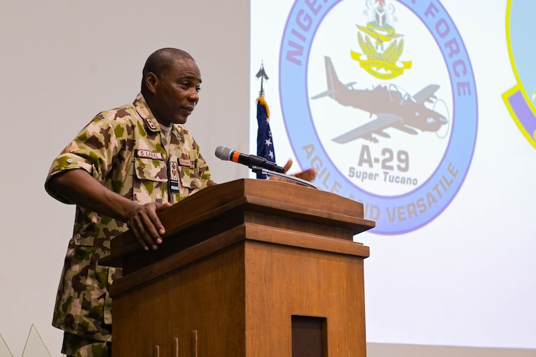 Nigerian Air Force Air Vice Marshal Sule Lawal, Nigerian A-29 program lead foreign liaison officer, gives a speech during the NAF A-29 pilot graduation ceremony at Moody Air Force Base, Georgia, Sept. 2, 2021. Each pilot has accomplished more than 70 hours of formal academics, 65 hours of simulators, and between 50-100 hours of flying, depending on their specific track. (U.S. Air Force photo by Senior Airman Rebeckah Medeiros)