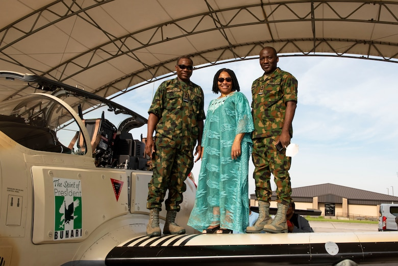 Sule Baba Lawal, Nigerian Air Vice-Marshal, right; Uzoma Elizabeth Emenike, Nigerian Ambassador, center; and Jibrin Usman, Nigerian Air Commodore, pose for a photo on the wing of an A-29 Super Tucano aircraft at Moody Air Force Base, Georgia, Sept. 14, 2021. The ambassador came to the 81st FS to meet and send off the pilots who are transporting the A-29 Super Tucano aircraft from Moody AFB to Kainji Air Base, Nigeria. (U.S. Air Force photo by Airman 1st Class Megan Estrada)