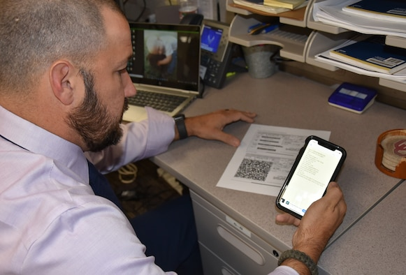 Jason Davis, 429th Supply Chain Management Squadron, demonstrates the amount of data available through a single QR code scan. Davis is an Air Force Materiel Command semi-finalist in the Spark Tank competition thanks to his idea to eliminate scanning errors and improve asset tracking by replacing four barcodes with a single QR code on a DOD form.