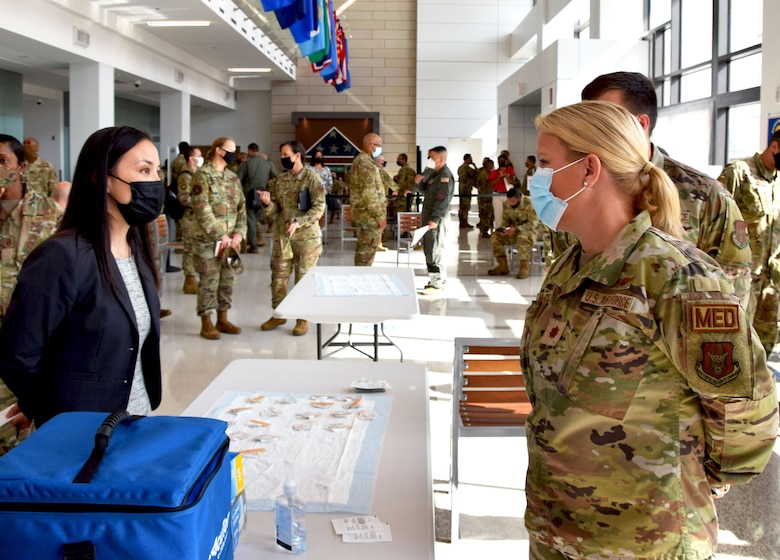 Under Secretary of the Air Force Gina Ortiz Jones speaks with Maj. Molly McCowan, 433rd Medical Squadron clinical nurse, during her visit to 433rd Airlift Wing members at Wilford Hall Ambulatory Surgical Center, Joint Base San Antonio-Lackland, Texas, to view COVID-19 vaccination efforts, Oct. 2, 2021. (U.S. Air Force photo by Tech. Sgt. Samantha Mathison)