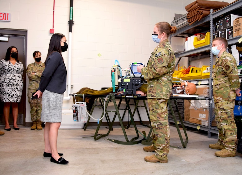 Under Secretary of the Air Force Gina Ortiz Jones visits with Maj. Dana Mayer, 433rd Medical Squadron critical care air transport team, at Joint Base San Antonio-Lackland, Texas, Oct. 2, 2021. (U.S. Air Force photo by Tech. Sgt. Samantha Mathison)