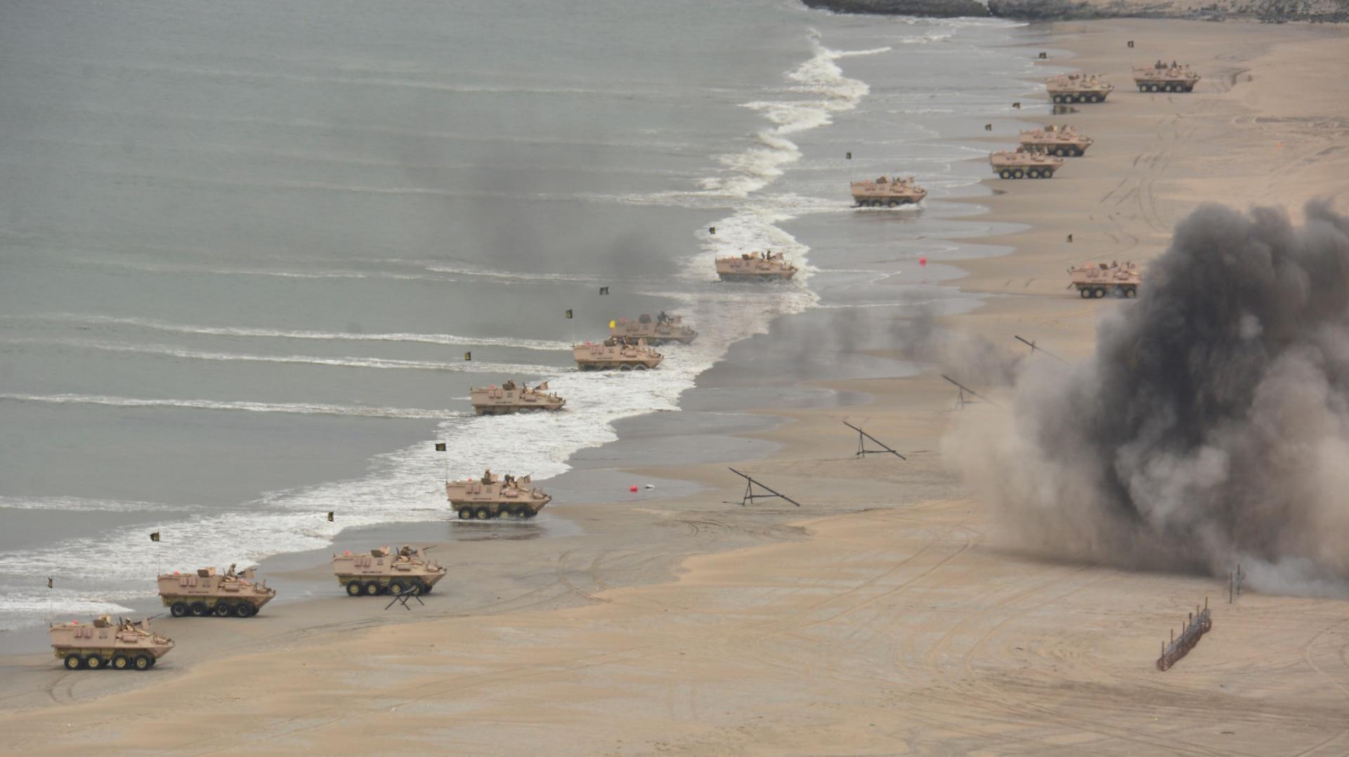 Peruvian marine amphibious assault vehicles land on Las Salinas Beach as part of the amphibious assault during UNITAS LXII.