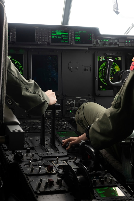 Lt. Col. Kira Coffey, 36th Airlift Squadron director of operations, left, and Capt. Garrett Mazachek, 36th AS pilot, operate a C-130J Super Hercules at Yokota Air Base, Japan, Oct. 1, 2021. Coffey and Mazachek supported four annual and wing level award winners on their flight and showcased a pilot's duty during flight. (U.S. Air Force photo by Staff Sgt. Joshua Edwards)