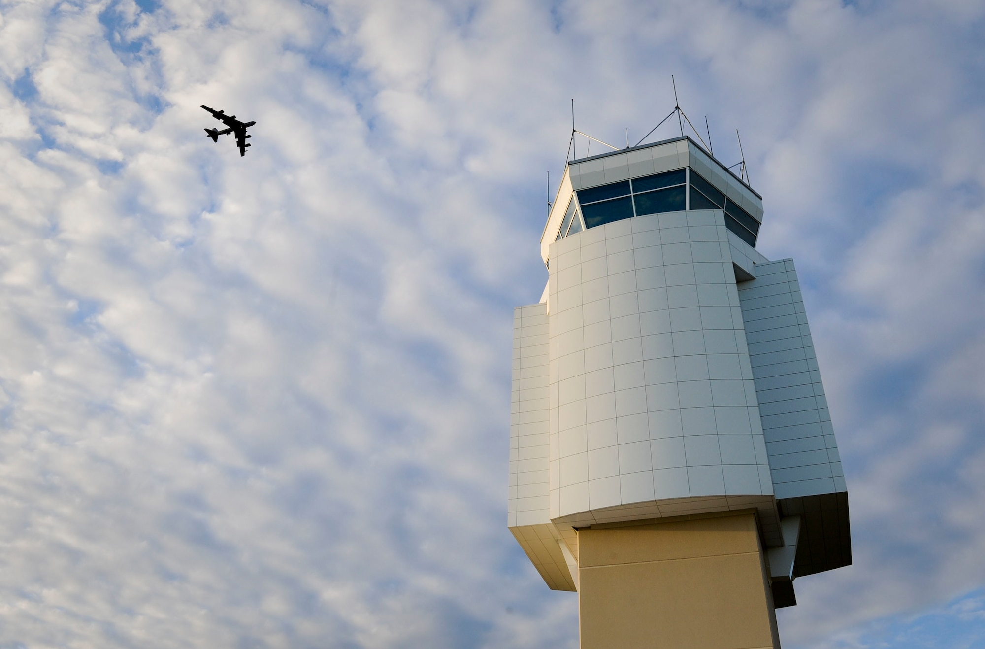 A B-52H Stratofortress flies above the Air Traffic Control Tower at Minot Air Force Base, N.D., June 20, 2017. During any in-flight emergency, it's an air traffic controller's responsibility to get the aircraft safely on the ground by clearing the airspace, communicating with the aircrew and ensuring emergency personnel are prepared to meet the aircraft when it lands. (U.S. Air Force photo by Senior Airman Sahara L. Fales)