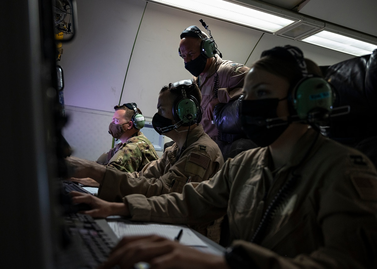 U.S. Airmen assigned to the 968th Expeditionary Airborne Air Control Squadron manage the airspace over Southwest Asia, March 12, 2021. In support of air-to-ground operations, the E-3 can provide direct information needed for interdiction, reconnaissance, airlift and close-air support for friendly ground forces. (U.S. Air Force photo by Senior Airman Bryan Guthrie)