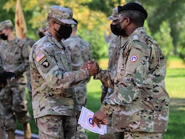 1st Sgt. Antwan Stanley, outgoing first sergeant,  Headquarters and Headquarters Company, Special Troops Battalion, 1st Theater Sustainment Command, is congratulated by the Soldiers of the 1st TSC following the company's t change of responsibility ceremony at Fort Knox, Kentucky, Oct 1., 2021. The change of responsibility ceremony symbolizes the transfer of responsibility from the outgoing first sergeant to the incoming first sergeant.