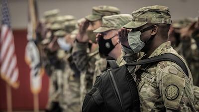 Service members in line saluting