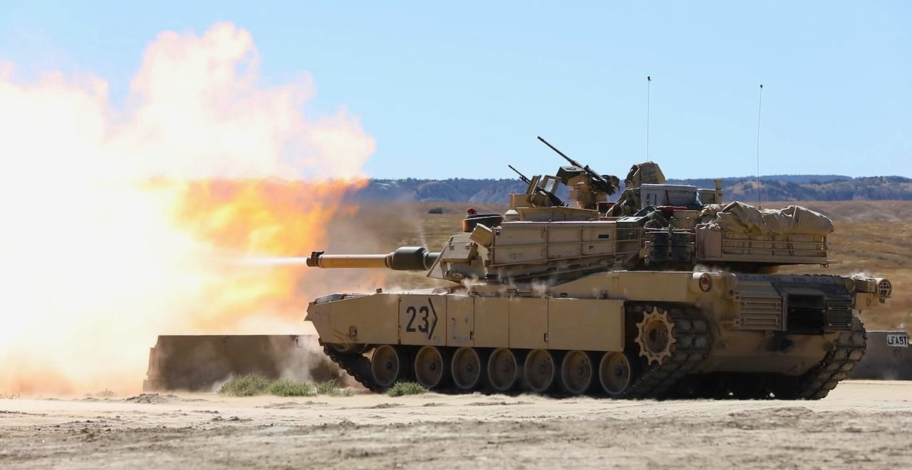 A tank fires a round.