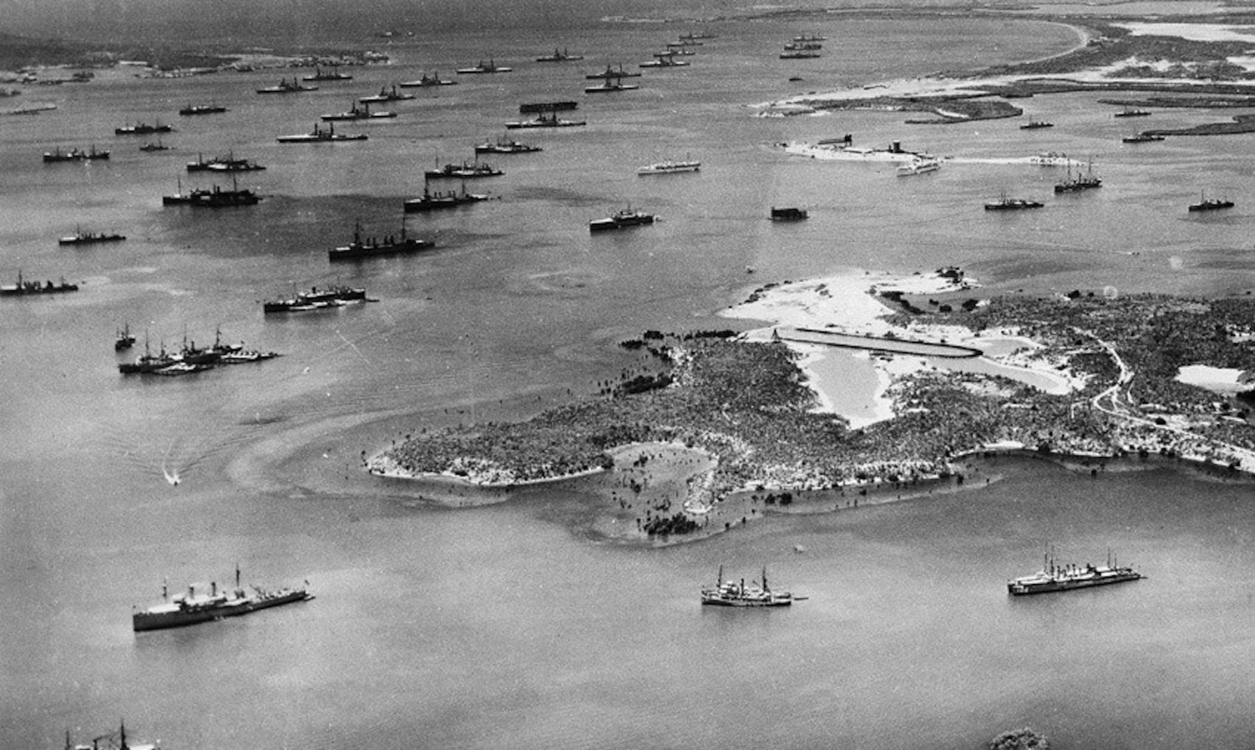 Aerial photo of Guantanamo Bay Naval Station in early 1940s, showing the fleet at anchor and seaplane ramp in the foreground. (U.S. Navy photo)