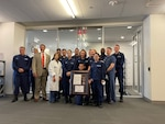 Members of Base National Capital Region receive their specific Health Clinic of the Year award, July 21, 2021. Every Coast Guard clinic will be recognized as the clinic of the year for 2020 based on how well the medical community responded to a global pandemic as well as hurricanes in 2020. U.S. Coast Guard photo by Keisha Reynolds.