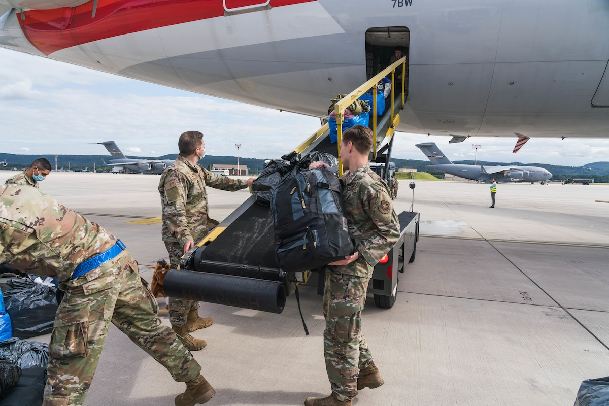 U.S. Air Force Airmen assigned to the 721st Aerial Port Squadron load luggage onto an American Airlines aircraft during Operation Allies Refuge at Ramstein Air Base, Germany, Aug. 27, 2021. Civil Reserve Air Fleet Aircraft are being used for the onward movement of evacuees from temporary safe havens and interim staging bases. (U.S. Air Force photo by Tech. Sgt. Donald Barnec)