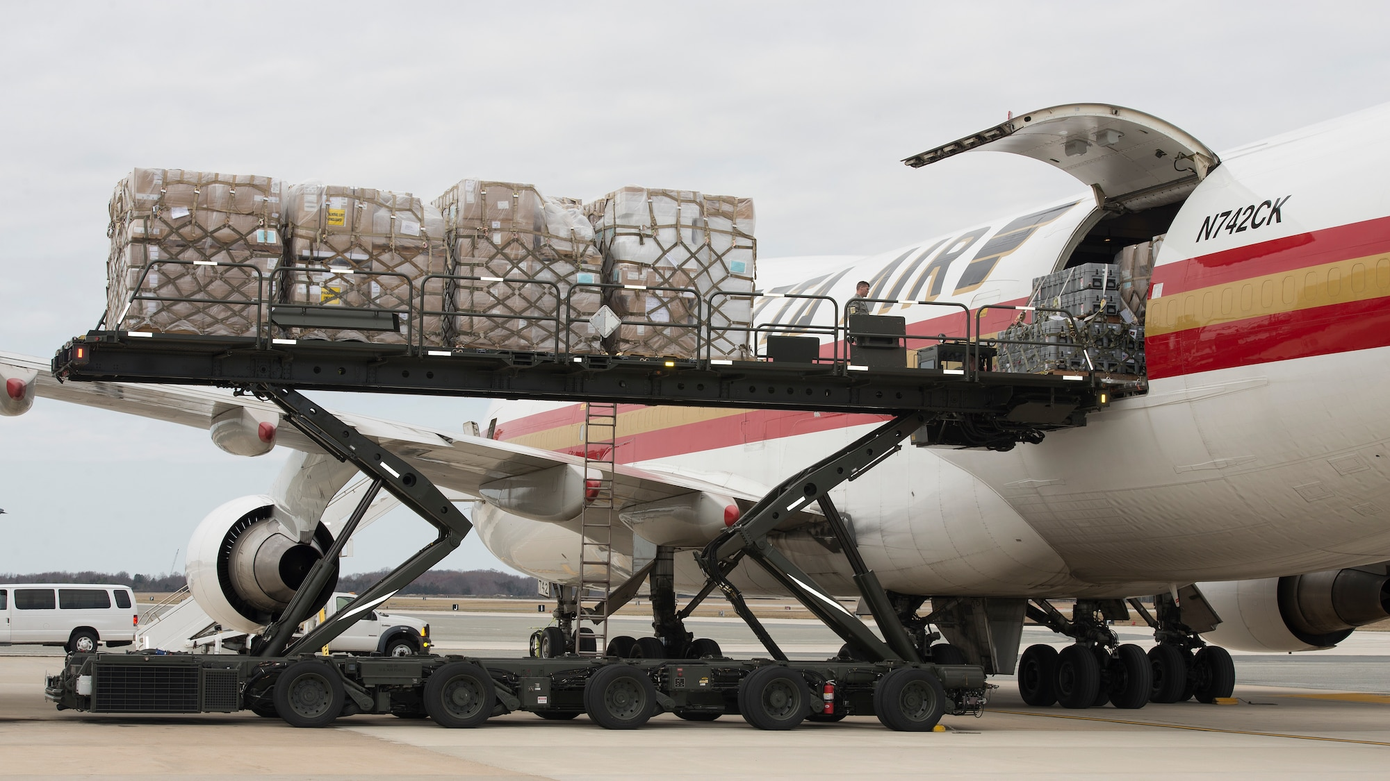 Cargo pallets are loaded onto a Kalitta Air Boeing 747 by 436th Aerial Port Squadron Airmen March 24, 2017, at Dover Air Force Base, Del. In addition to military airlifters, Dover AFB regularly sees civilian cargo planes that support Department of Defense missions. (U.S. Air Force photo by Senior Airman Zachary Cacicia)