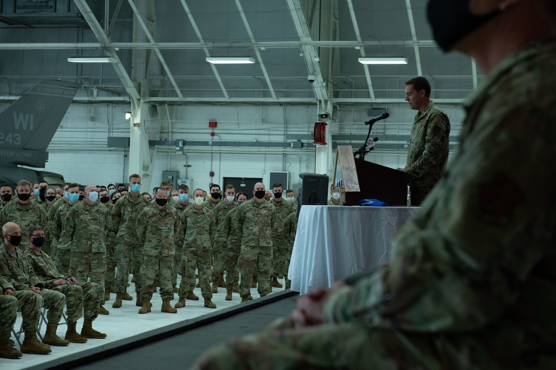 U.S. Air Force Capt. Roger Roth, master of ceremonies, speaks to deployers during a sendoff ceremony for the 115th Fighter Wing and the 378th Fighter Squadron Sept. 11, 2021. The unit will deploy to Asia for three months for its final combat deployment using F-16 Fighting Falcon aircraft before the transition to F-35 Lightning II aircraft.