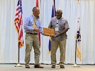 Larry Bowden of Naval Sea Systems Command's Surface Ship Maintenance, Modernization and Sustainment (NAVSEA 21) directorate, recently received the 2021 Hileman Award during MegaRust 2021.