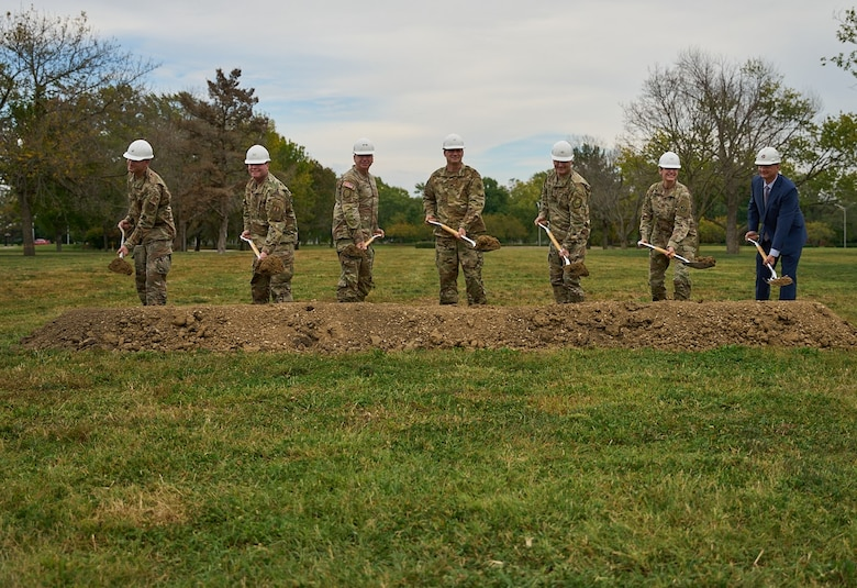 military leaders and construction president break ground