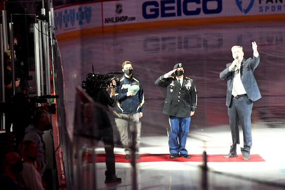 Chicago Blackhawks National Hockey League team honors Sgt. Maj. Dennis Koski, right, 85th U.S. Army Reserve Support Command and U.S. Navy Veteran Lt. j.g. Ash Davis, during a home game at the United Center in Chicago, October 1, 2021.