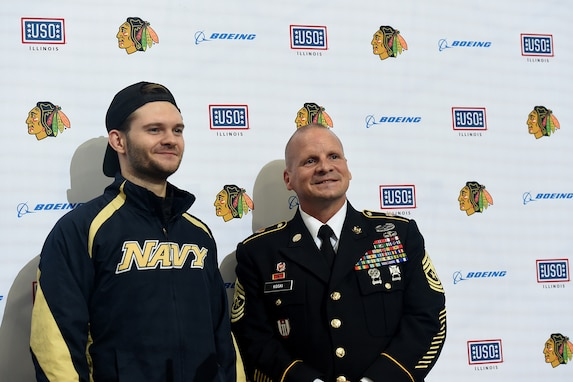 Chicago Blackhawks National Hockey League team honors Sgt. Maj. Dennis Koski, right, 85th U.S. Army Reserve Support Command, and U.S. Navy Veteran Lt. j.g. Ash Davis, during a home game, at the United Center in Chicago, October 1, 2021.