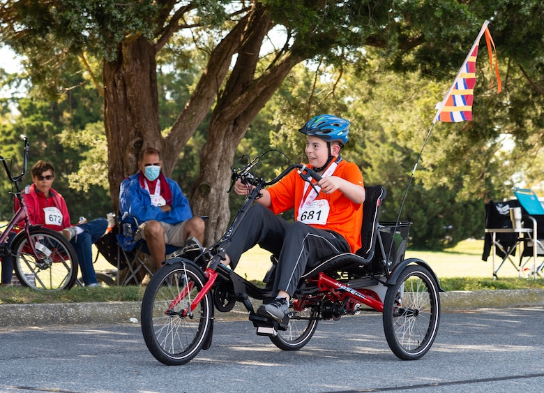Matthew Lavelle, of the Wilmington Wizards, pedals his way to the finish line at the 2021 Special Olympics Delaware Cycling Classic at Dover Air Force Base, Delaware, Oct. 2, 2021. Lavelle competed in the 1K and 2K tricycle races. (U.S. Air Force photo by Roland Balik)
