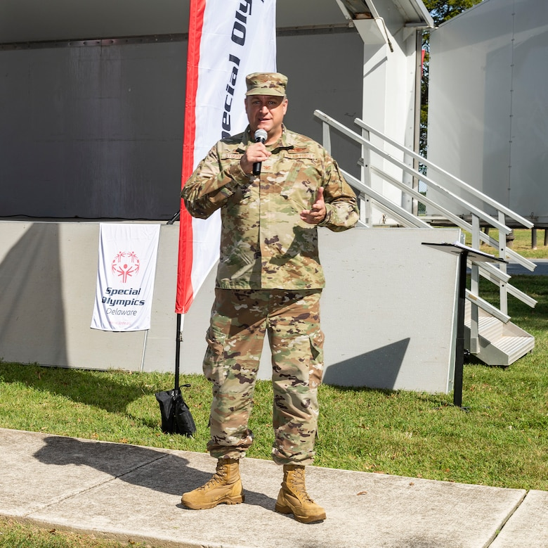 Col. Douglas Stouffer, 512th Airlift Wing commander, makes closing remarks at the 2021 Special Olympics Delaware Cycling Classic at Dover Air Force Base, Delaware, Oct. 2, 2021. Stouffer noted the return of the cycling classic to Dover AFB after last year's absence due to the pandemic. (U.S. Air Force photo by Roland Balik)