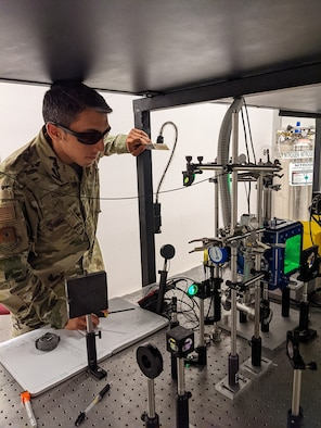 First Lt. Ashwin Rao checks equipment alignment for his laser-induced breakdown spectroscopy experiments at the Air Force Institute of Technology, Wright-Patterson Air Force Base, Ohio.