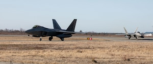 Two F-22 Raptor fighter jets assigned to the 90th Fighter Squadron, 3rd Wing, Joint Base Elmendorf-Richardson, Alaska, taxi in King Salmon, Alaska May 5, 2021 in support of flight operations above the Joint Pacific Alaska Range Complex and Gulf of Alaska during Exercise Northern Edge 2021 (NE21).