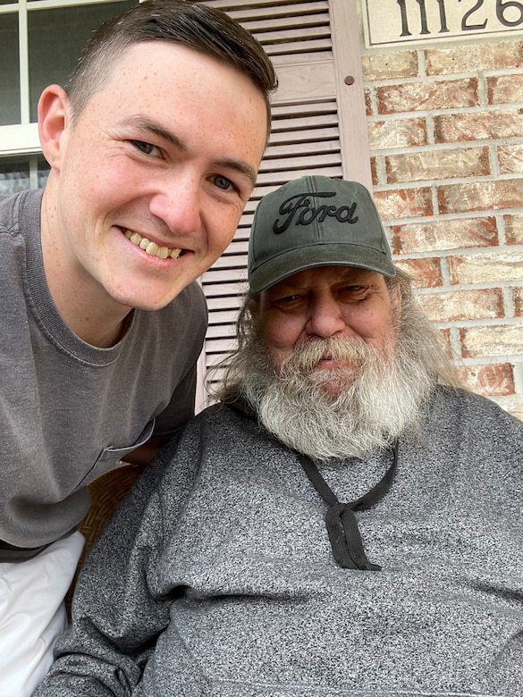 Airman 1st Class Austin Jacobs visits his neighbor, George Metzger after being released from the hospital in his hometown of Indiana on Apr. 16, 2021 (Courtesy Photo)