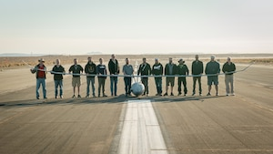 Platform Aerospace and Emerging Technologies-Combined Test Force personnel celebrate the Vanilla unmanned aircraft system's record-setting flight of 8 days, 50 minutes, and 47 seconds, and 12,200 miles of continuous flight, at Edwards Air Force Base, California, Oct 2. The aircraft broke the world record for unrefueled, internal combustion endurance of an unmanned aircraft and was launched from Rogers Dry Lakebed on Friday, Sept. 24. (Air Force photo by Bryce Bennett)