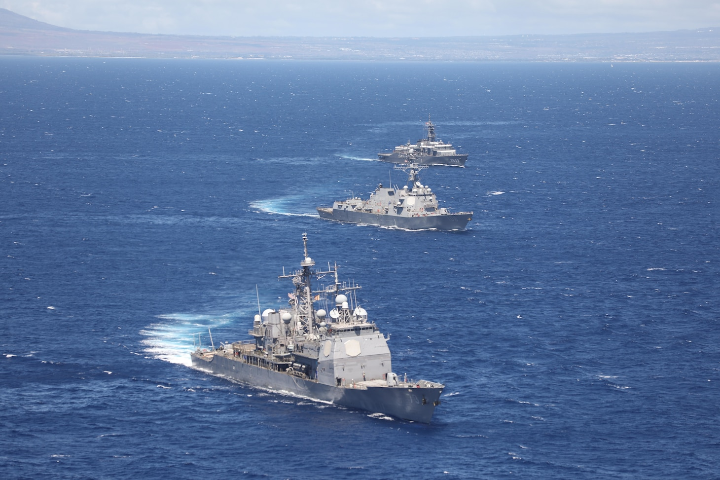 PACIFIC OCEAN (Oct. 4, 2021) Front to back, Ticonderoga-class guided-missile cruiser USS Port Royal (CG 73), Arleigh-Burke class guided-missile destroyer USS Wayne E. Meyer (DDG 108) and Japan Maritime Self-Defense Force (JMSDF) ship JS Kashima (TV-3508) participated in a Cooperative Deployment (CODEP). Cooperative Deployments are designed to increase operational readiness and interoperability between participating ships, increase planning and communication abilities, and improve complex maritime operations efficiency and effectiveness. (U.S. Navy photo by Mass Communication Specialist 2nd Class Aja Bleu Jackson)