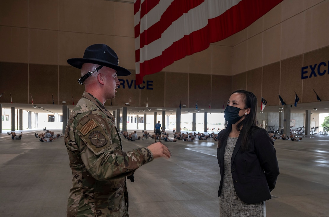 Undersecretary of the Air Force talking to an Airman.