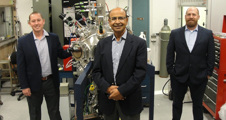From left, Dr. Nick Glavin, Dr. Ajit Roy, and Dr. Michael McConney stand with a nanomaterial Deposition Chamber at the Air Force Research Laboratory's Materials and Manufacturing Directorate. They are leading an effort to increase the availability of nano materials by building stronger ties with industry, government and academia in India. (U.S. Air Force photo/Patrick Foose)