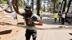 Seaman Nate Dirvin crosses the finish line after running 135 miles through Death Valley to Mount Whitney in California, July 19, 2021. He completed the Badwater 135 to raise funds for Coast Guard Mutual Assistance. U.S. Coast Guard photo.
